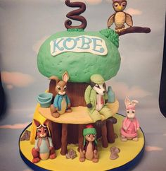 Cake by fluffycakesco Peter Rabbit treehouse cake with all of Kobe's favourite characters!