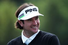 Bubba Watson of USA looks on during the first practice ...