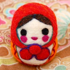 I really want to learn how to do needle felting.  How cute is this Matryoshka?