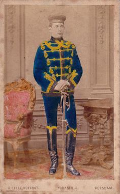 A hand colored studio portrait of a young Leib Garde Hussar in winter walking out dress.