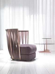 I like this chair back because it has triangular shapes that remind me of sails and is still modern to fit in with my design statement. Armchair by Cantori