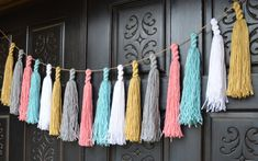 Yarn Tassel Garland by HouseOfMark on Etsy, $35.00; Love these! They are more durable than the paper tissue variety. CA seller (3-5 day lead time). Coordinated to match party.