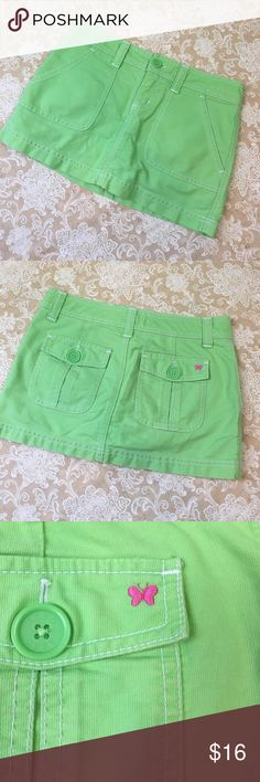 Aeropostale Lime Green Skort Super cute lime green skort. Pockets in the front and back. Love the little pink butterfly on the back pocket! 100% cotton. New condition. Size 0.  Waist measured flat 14 inches and length 11 inches. SK332 LOC-3 Aeropostale Shorts Skorts