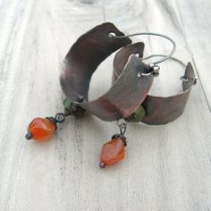 These rustic bohemian style copper hoops are handmade in a nice small to medium size . Theyre quite lightweight for their size and visual impact. All