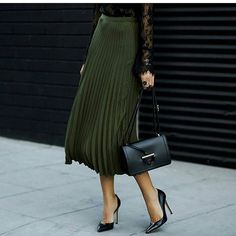Olive pleated skirt + black leather crossbody + black courts + lace body