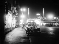 Here's a real Angeleno film noir sort of night for you. This is 1937 and we're near the corner of Wilcox and Selma Avenues looking north toward Hollywood Boulevard. We can see the Hotel Mark Twain, the Warner Brothers' Hollywood Theater, and the twin KFWB radio masts (which are still there today.) All we need is a trench coat, a set of brass knuckles, and a dame with a secret, and we'd be all set.
