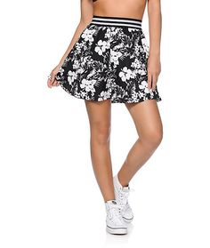 Dress up your casual look with this black and white print skirt cut with a skater silhouette for a flattering fit and a contrast stripe elastic waistband.