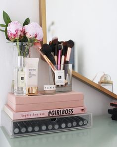My Makeup Collection! - KATE LA VIE - Kate La Vie - Dressing table/vanity make up storage room tour - serious love for the Peony and touches of pink here, with that little touch of gold to bring in the mirror frame.