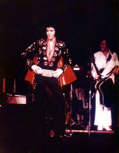 "Elvis - November 10,1971 at the Boston Garden. He's wearing the jumpsuit known by the fans as the Black Matador. | Steve Toli © A reporter of the Boston Globe: ""He bumped and grinned, flailed his arms, jerked his head in tempo, strutted around the stage like a pompous wrestler and postured outrageously throughout his whirlwind set to the shrieking delight of his fans."""