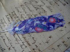 UNIQUE Real Cockatoo Feather, Hand Marbled ,Colorfast Paint, with Purple, Scarlet and Turquoise. $7.00, via Etsy.