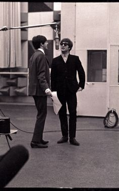 """""""We're in the studio here,"""" says Ringo of this shot of John and Paul. """"We can only be doing the vocals the way the boys are dressed. My guess is that this is 1964, but these outfits look a little later than that. John and Paul always sang into the same microphone when they did harmonies, and if George was singing he'd be on the same mic too. And that's why the harmonies are so great because they're close to each other and they can hear each other."""" Photo by Ringo Starr"""
