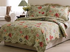 This American Traditions Edens Garden quilt set features flowering vines on a bed of sage green with detailed machine stitching and scalloped edges. Set includes one x quilt and two pillow shams, x Cotton with cotton blend fill. Garden King, Pillow Shams, Pillows, Cushions, Twin Quilt, Queen Quilt, Quilt Sets, Bed Spreads, Covet Fashion