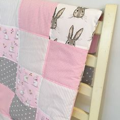 One of our newer patchwork quilt designs - pink and grey bunnies. Available in the larger 100x120cm (cot bed size). Matching storage baskets and cot bar bumpers also available