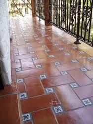 Andalusian designs: tile, water features, court yards -Terracotta with blue tile