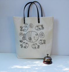 b7e3f3fe10f Canvas tote bag hand embroidered with fishes in black, handmade bag, one of  a kind, Shoppers bag