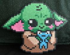 Perler Bead Pixel art Craft of Baby Yoda. Handmade out of plastic fuse beads. Perler Bead Disney, Pokemon Perler Beads, Diy Perler Beads, Perler Bead Art, Hama Beads Kawaii, Melty Bead Patterns, Pearler Bead Patterns, Perler Patterns, Beading Patterns