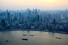 The view of Shanghai from the Oriental Pearl TV Tower. http://bzfd.it/1naZ6MU