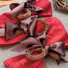 Tablescapes - Simple Christmas Decorating Idea: Create grapevine napkin rings, tie rings with ribbon on to napkins for a subtle touch