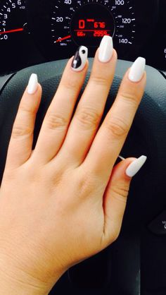 White coffin acrylic gel nails with yin yang design. Photo by: @ipinkiwantyou