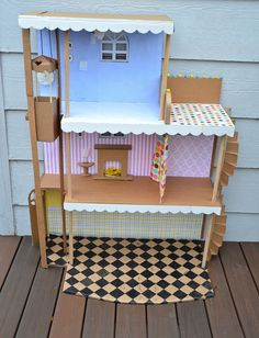 A dolls house made out of cardboard. This is pure delight and I would love to get my boys involved in making this for her. In fact I almost want to do it all myself:)