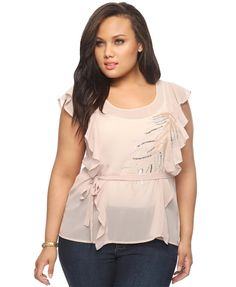 Flattering. Like the nude/peach color and the ruffles!