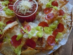 Old Chicago copycat Italian Nachos. With wonton chips, mozzerella cheese, pepperoni, and peperoncinis.