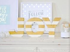 Perfect holiday gift! DIY striped gold and white JOY Christmas decor letters via Kara Allen | Kara's Party Ideas | KarasPartyIdeas.com for Michaels #MichaelsMakers