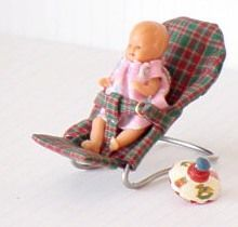 dollhouse mini baby seat tutorial..in German but the tute pics are easy to follow (or just translate the site)