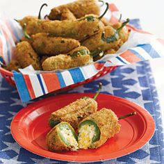 I don't like spicy but i will try this with banana peppers   24 small jalapeño chilis  1 (8 oz.) package cream cheese, softened   1 cup grated Cheddar (4 oz.)   2 tablespoons chopped fresh cilantro  1 cup all-purpose flour  2 large eggs, beaten $  1 cup plain bread crumbs  Salt and pepper