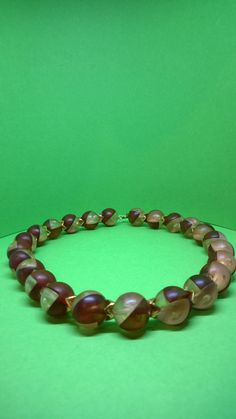 Vintage / retro attractive brown and clear combined round plastic bead necklace by ThePemburyEmporium on Etsy