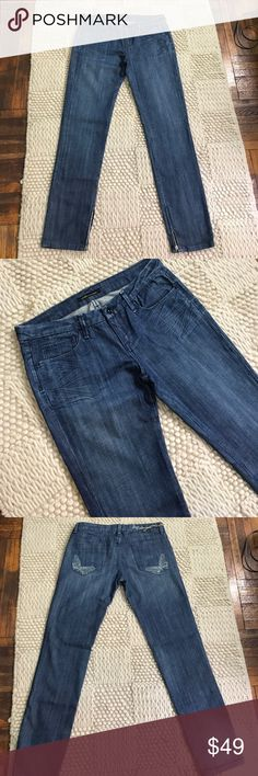 """Anomame Jeans Blue jeans with zippered ankles and a butterfly design on the back pockets. New jeans have never been used. Inseam 32.25"""",  Rise 8.5"""", Waist 16.25"""" Anoname Jeans"""