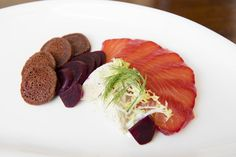 Cardinal Gin Cured Salmon: barrel rested gin cured salmon, blinis, spiced crème fraîche