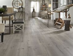 This Fall Flooring Season see 100 NEW flooring styles like Driftwood Hickory EVP. It's part of a new line of waterproof flooring that's ideal for any space at home!