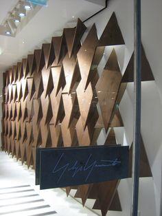 YOHJI YAMAMOTO STORE // PARIS    INTERIORS / LAYERS / SPIKEY / TRIANGLES / WALL / WOOD ... makes me think of RISD's Design Principles ...