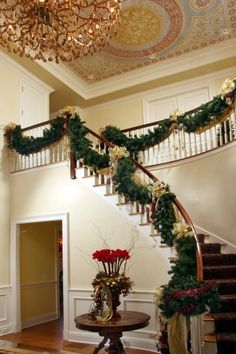 Sharon McCormick - Interior Designer - Connecticut - Foyer - Staircase - Chandelier - Tiled Ceiling - Prints - Design - Painted Walls - Wood Staircase - Holiday - Christmas - Garland - Wreath - Decor - Cozy - Wood Floors - Gold - Neutrals