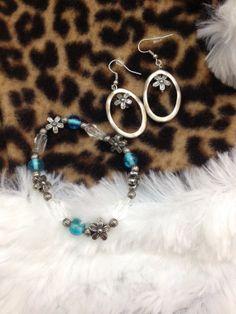 Silver metal flower bracelet and earring set by ReadyByDawn, $10.00