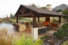 covered outdoor kitchen/fireplace