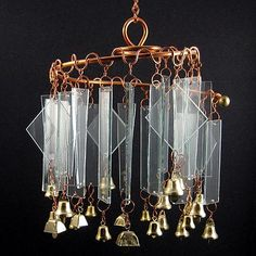 Copper, Brass & Glass Wind Chimes. I like the type of glass; light & clear, but not the brass & metal. I'd like it with small wood branches.