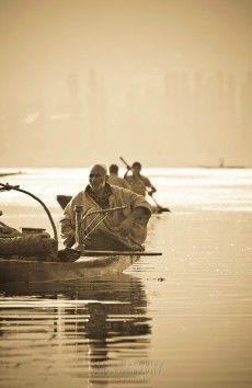 Muslim man with hooka on a Shikara, or gondola boat, on Dal Lake, Srinagar, Kashmir, India. | St ...