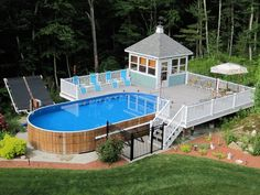 Above ground pool with deck, pool house, and solar heater