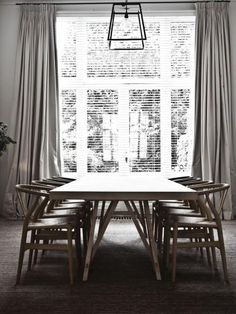 The home of Melanie Ireland in Antwerp, designed by Vincent Van Duysen. Dining room with chairs by Hans Wegner.  Photo credit Karel Balas.
