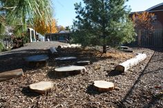 Outdoor play area...set up like hopscotch and paint #'s on the logs! Now I need a tree that has been cut down..