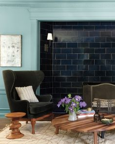 Use tile in unexpected spots, like these glossy blue tiles that replaced wood paneling.: