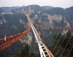 Glass Suspension Bridge Under Construction In Zhangjiajie [ChinaFotoPress via Getty Images]