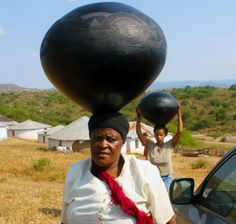 Magwaza women with their ceramic vessels.