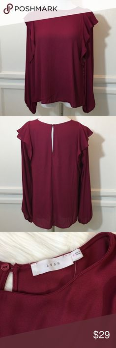 """Lush Blouse This is a NWT Long Sleeve Lush Blouse. Color is called Beet Red. It's a beautiful Wine color. Features include a ruffle down the sides, a keyhole at back of neck with button closure and banded elastic wrist. Approximate measurements are Width 21"""", Length 25"""". Lush Tops Blouses"""