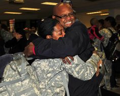 FAYETTEVILLE, N.C. - North Carolina National Guard Army Sgt. Sade Fuller hugs her father, Fred Fuller, after returning from a tour in Afghanistan with the 105th Engineer Battalion at the Fayetteville, N.C., Regional Airport here today. The unit, provided command and control of combat engineer units conducting route-clearing missions, ensuring U.S. and Coalition forces had freedom of movement within their areas of operation.