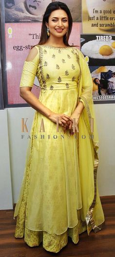 Buy Online from the link below. We ship worldwide (Free Shipping over US$100) Click Anywhere to Tag Divyanka Tripathi in Kalki yellow suit in brocade silk in zardosi and moti work ake your style game a notch higher with this indo western suit that is perfect fo all your pre-wedding functions. The yellow suit has a under layer cold shoulder tunic in brocade silk and is matched with a top layer in tissue that is embellished beautifully with moti and zardosi butti work. It is matched with a…