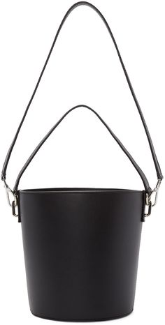 Structured lightly grained leather bucket bag in black. Carry handle at top. Detachable shoulder strap with lanyard clasp fastening. Logo embossed at face. Textile panelling with leather drawstring closure at bag throat. Tonal textile lining. Silver-tone hardware. Tonal stitching. Approx. 10