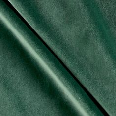 P Kaufmann Obsession Velvet Emerald from @fabricdotcom  This luxurious velvet will add sophistication to any home decor style and is perfect for window treatments, accent pillows, upholstering headboards, furniture, ottomans and more. This fabric has 210,000 double rubs.